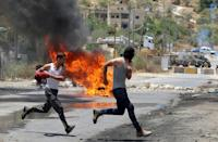 Palestinian protesters clash with Israeli security forces in the village of Beita, south of Nablus, in the occupied West Bank on June 8, 2021