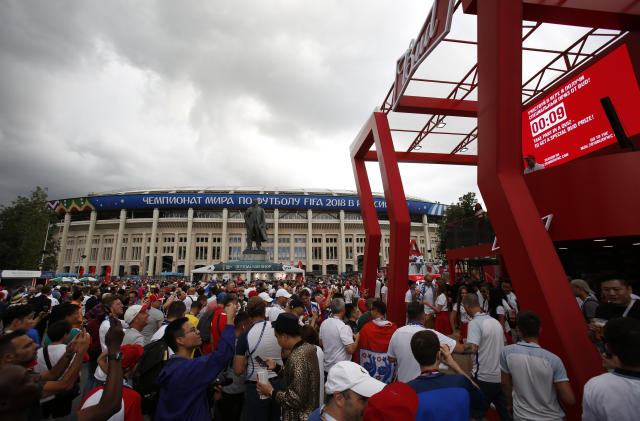 "In this July 11, 2018 photo, people walk past a Budweiser pavilion near a statue of Lenin as fans arrive for the semifinal match between Croatia and England at Luzhniki Stadium, during the 2018 soccer World Cup in Moscow, Russia. When Lenin had a thirst for revolution, this is not what he had in mind. Fans attending Sunday's World Cup final between France and Croatia will pass a huge statue of the Bolshevik Revolution's leader as they enter Luzhniki Stadium. Abutting the rear of the monument is a Budweiser concession stand with a sign proclaiming: ""Drink smart today _ celebrate tomorrow."" (AP Photo/Rebecca Blackwell)"