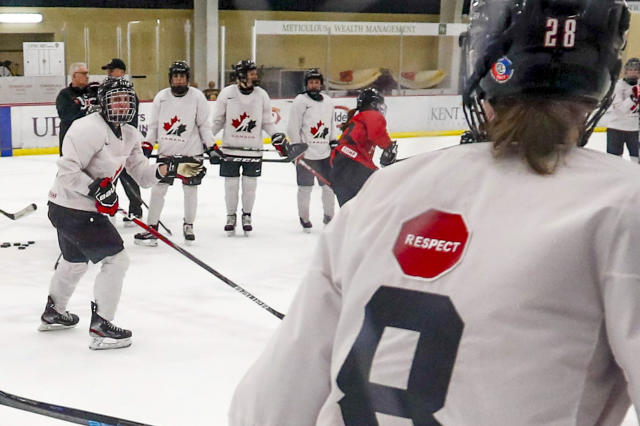"""In this photo taken Monday, Nov. 4, 2019, Micah Hart, right, of the Canada Women's National hockey team, wears a """"respect"""" patch on the back of a practice sweater as they go through drills during a practice in Cranberry Township, Butler County, Pa. Many of the top women's hockey players on the planet say they're resolute in their decision to not play professionally in North America until a new league that provides better pay and better benefits materializes. (AP Photo/Keith Srakocic)"""
