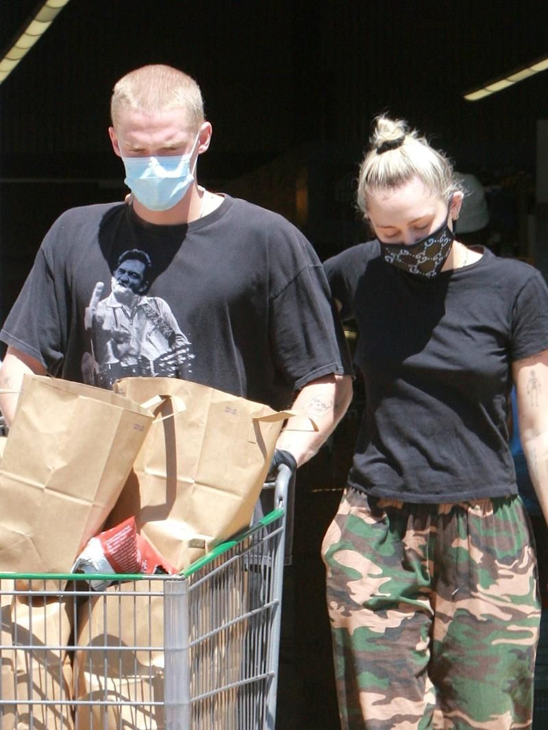 Cody Simpson and Miley Cyrus pictured grocery shopping in April (Photo: JishPhoto/Shutterstock)