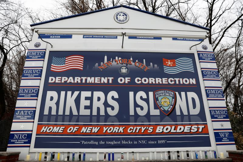 FILE PHOTO: Candles are seen on the sign marking the entrance to the New York City Department of Corrections Rikers Island facility in Queens, in New York