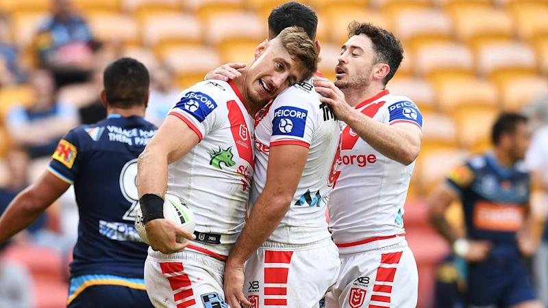 Zac Lomax (2L) has scored a try in St George Illawarra's much-needed 20-8 NRL win over Gold Coast
