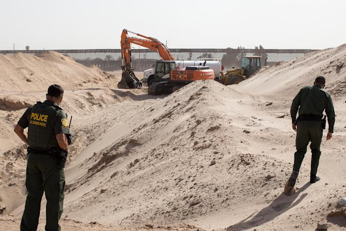 Federal agents inspect destroyed tunnel Oct. 26, 2020, said to have been built by Mexican cartels. (Gabriella Angotti-Jones/The New York Times)