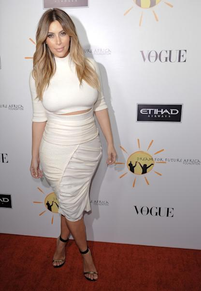 FILE - In this Oct. 24, 2013 file photo, Kim Kardashian arrives at the inaugural Dream for Future Africa Foundation Gala at Spago in Beverly Hills, Calif. The California Highway Patrol says it cited Kardashian for speeding on Tuesday, Nov. 12, 2013, after seeing the reality star apparently being chased by paparazzi on a Los Angeles freeway. (Photo by Richard Shotwell/Invision/AP, File)