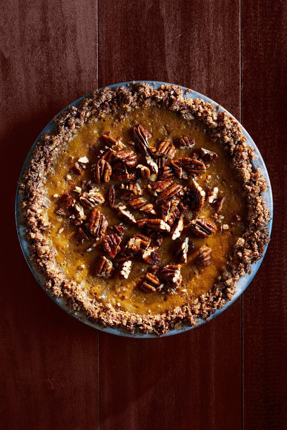 """<p>Take this year's pumpkin pie to the next level by adding sweet candied pecans.</p><p><strong><a href=""""https://www.countryliving.com/food-drinks/recipes/a36554/pumpkin-pie-with-oat-pecan-crust/"""" rel=""""nofollow noopener"""" target=""""_blank"""" data-ylk=""""slk:Get the recipe"""" class=""""link rapid-noclick-resp"""">Get the recipe</a>.</strong> </p>"""