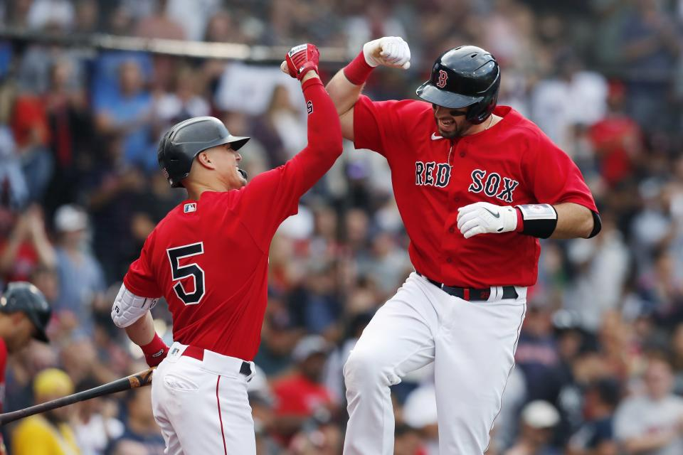 Boston Red Sox's Kevin Plawecki celebrates his solo home run with Enrique Hernandez (5) during the third inning of a baseball game, Saturday against the New York Yankees, Sept. 25, 2021, in Boston. (AP Photo/Michael Dwyer)