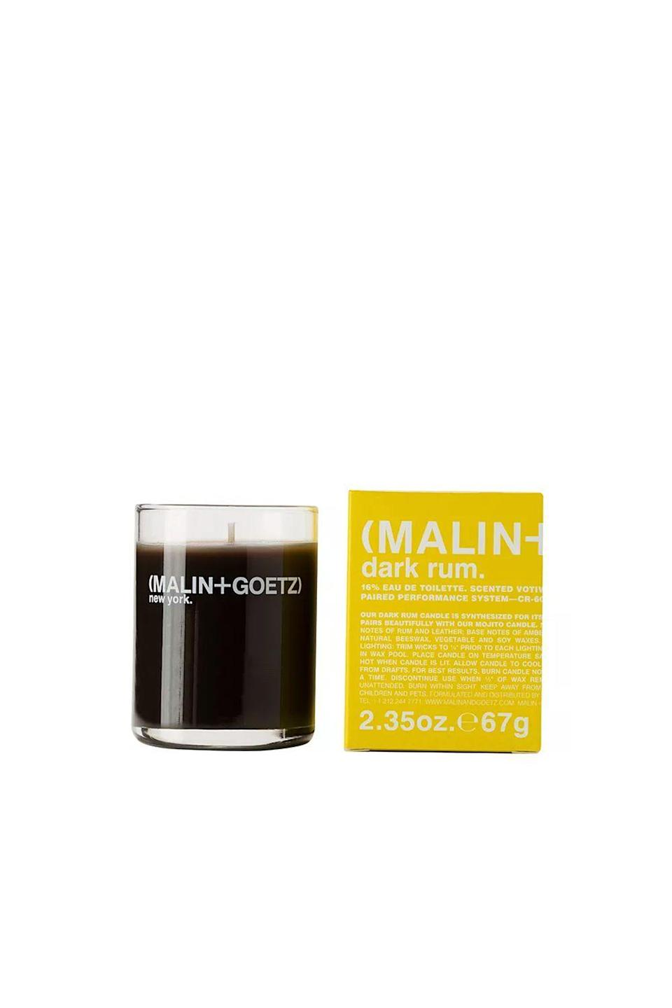 """<p><strong>MALIN+GOETZ</strong></p><p>bloomingdales.com</p><p><strong>$20.00</strong></p><p><a href=""""https://go.redirectingat.com?id=74968X1596630&url=https%3A%2F%2Fwww.bloomingdales.com%2Fshop%2Fproduct%2Fmalingoetz-dark-rum-votive-candle%3FID%3D948955&sref=https%3A%2F%2Fwww.oprahmag.com%2Flife%2Fg27562264%2Fbest-fall-scented-candles%2F"""" rel=""""nofollow noopener"""" target=""""_blank"""" data-ylk=""""slk:SHOP NOW"""" class=""""link rapid-noclick-resp"""">SHOP NOW</a></p><p>This exotic aroma combines bergamot and plum, rum and leather, and amber-patchouli and vanilla.</p>"""
