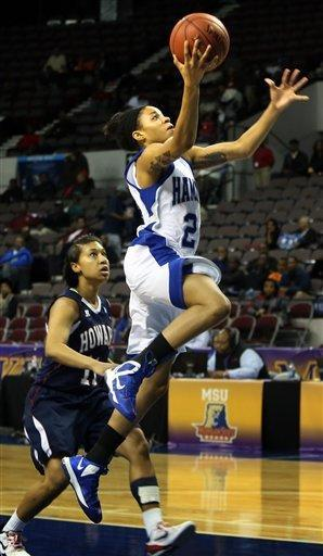 Hampton's Olivia Allen goes to the bakset on a fast break past Howard's Adelle Walton during an NCAA college basketball game in the Mid-Eastern Athletic Conference tournament championship, Saturday, March 16, 2013, in Norfolk, Va. (AP Photo/The Virginian-Pilot, Steve Earley)