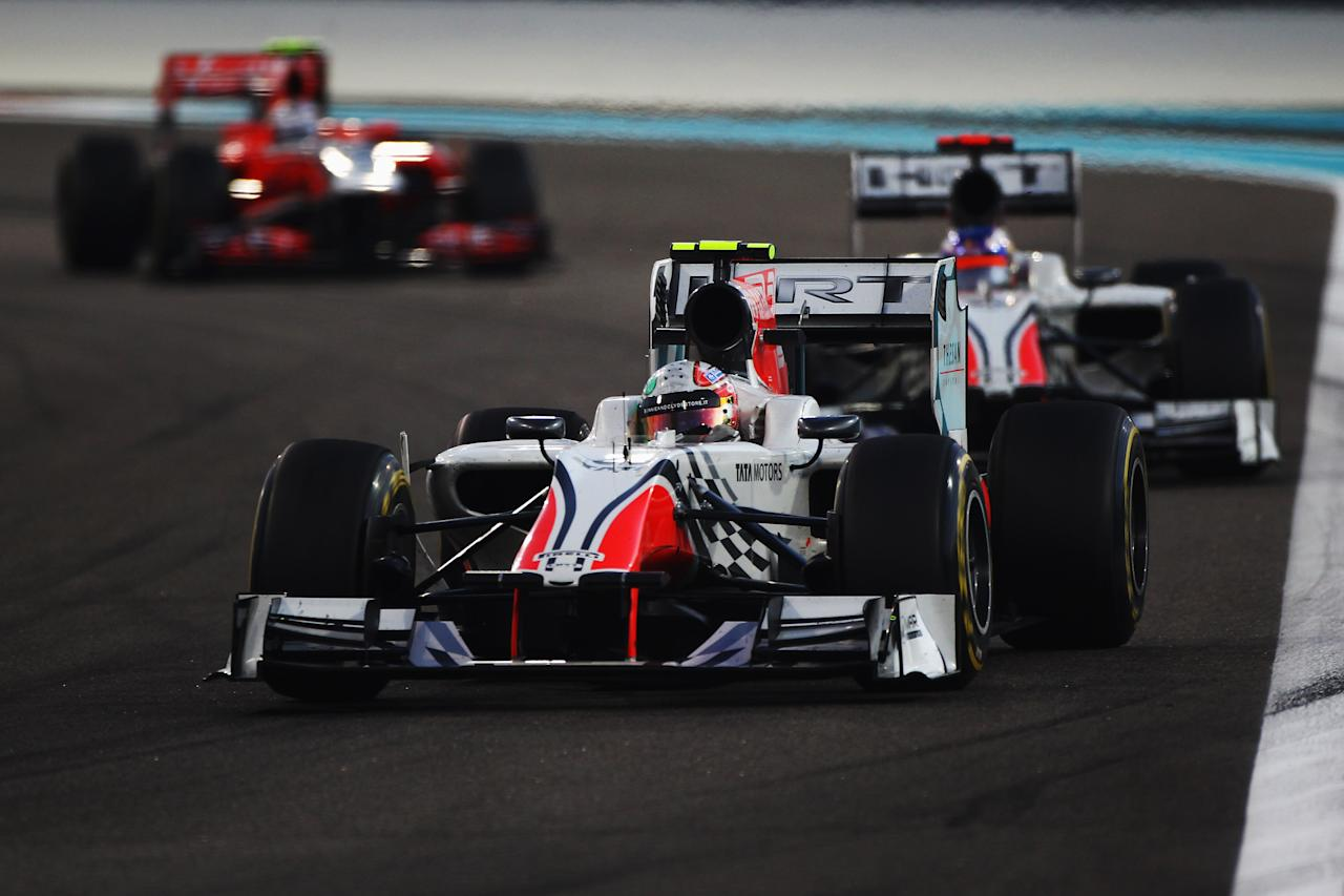 ABU DHABI, UNITED ARAB EMIRATES - NOVEMBER 13:  Vitantonio Liuzzi of Italy and Hispania Racing Team drives during the Abu Dhabi Formula One Grand Prix at the Yas Marina Circuit on November 13, 2011 in Abu Dhabi, United Arab Emirates.  (Photo by Clive Mason/Getty Images)