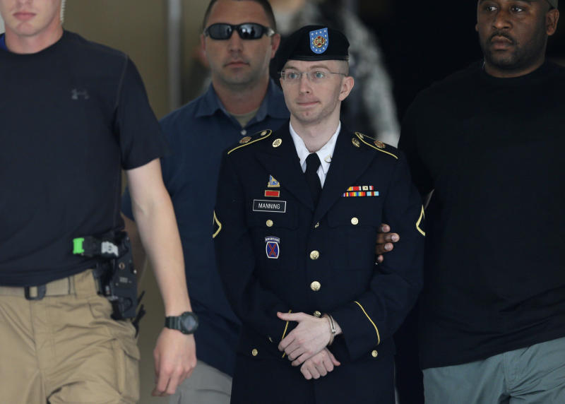 Army Pfc. Bradley Manning is escorted out of a courthouse in Fort Meade, Md., Tuesday, July 30, 2013, after receiving a verdict in his court martial. Manning was acquitted of aiding the enemy, the most serious charge he faced, but was convicted of espionage, theft and other charges, more than three years after he spilled secrets to WikiLeaks. (AP Photo/Patrick Semansky)