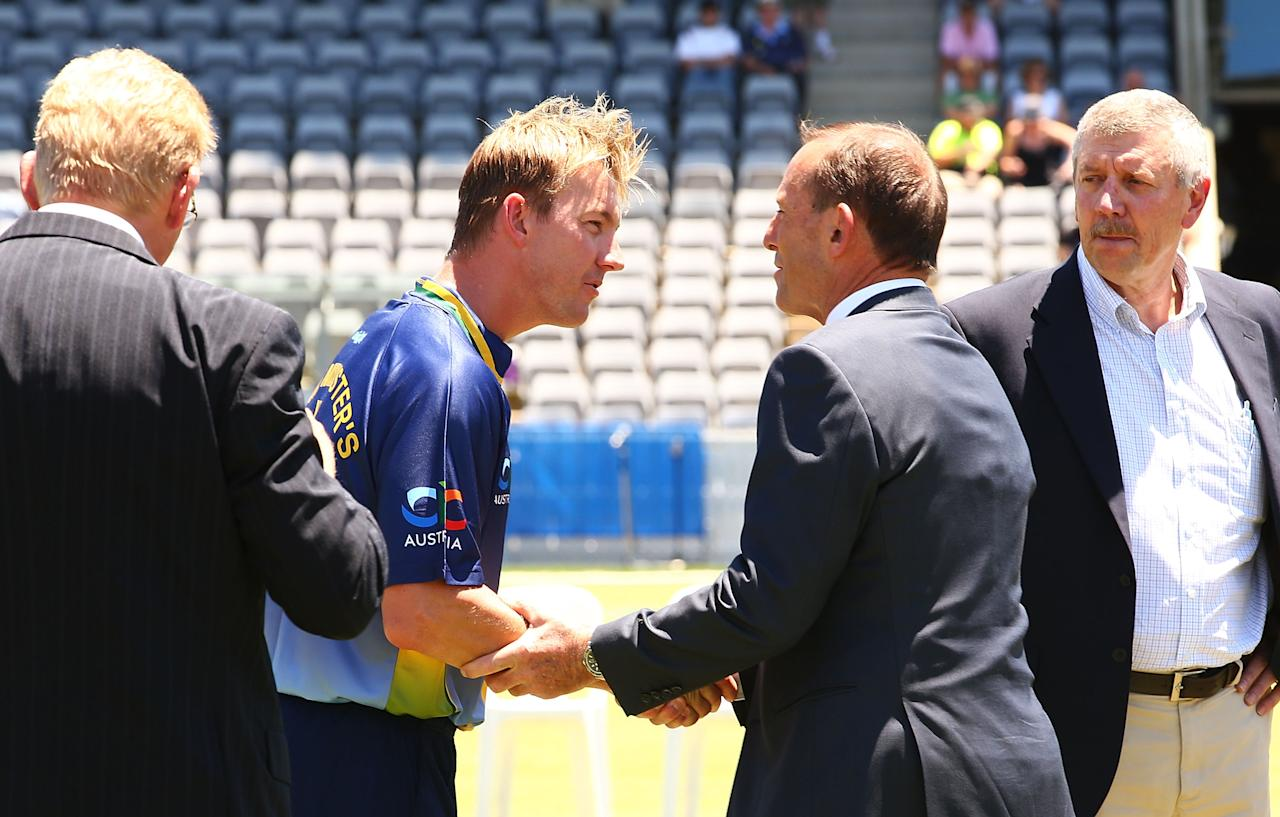 CANBERRA, AUSTRALIA - JANUARY 14: Brett Lee of the Australian PM's XI greets  The Australian Prime Minister Tony Abbott for the coin toss before the International tour match between the Prime Minister's XI and England at Manuka Oval on January 14, 2014 in Canberra, Australia.  (Photo by Mark Nolan/Getty Images)
