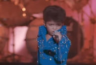 """<p>In a movie full of Elvis impersonations, one stands out: the 6-year-old who sings """"Can't Help Falling in Love"""" with a perfect Presley swagger. As it happens, the tiny impressionist was <a rel=""""nofollow"""" href=""""https://www.yahoo.com/music/tagged/bruno-mars"""" data-ylk=""""slk:Bruno Mars"""" class=""""link rapid-noclick-resp""""><span>Bruno</span> <span>Mars</span></a>, who began <a rel=""""nofollow noopener"""" href=""""http://www.mtv.com/news/2800527/bruno-mars-in-honeymoon-in-vegas/"""" target=""""_blank"""" data-ylk=""""slk:mimicking the King at the age of 4"""" class=""""link rapid-noclick-resp"""">mimicking the King at the age of 4 </a>as part of his family's musical act. —<em>Gwynne Watkins</em> (Photo via YouTube) </p>"""