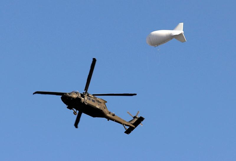 A NATO helicopter flies over the Resolute Support headquarters in Kabul