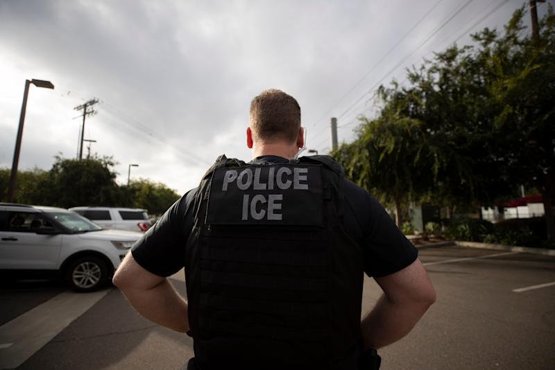 A U.S. Immigration and Customs Enforcement (ICE) officer looks on during an operation in Escondido, Calif. on July 8, 2019.