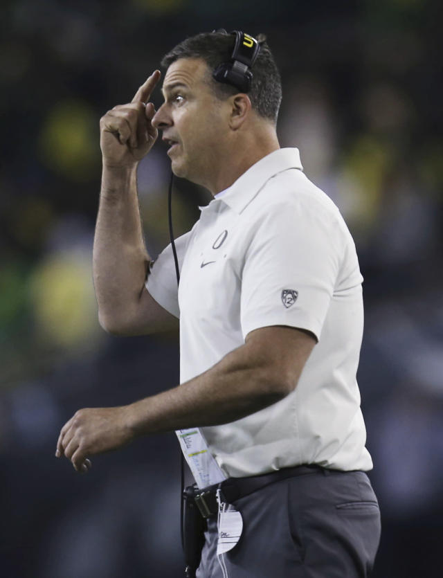 Oregon coach Mario Cristobal makes a point to his team during the third quarter of an NCAA college football game against Colorado on Friday, Oct. 11, 2019, in Eugene, Ore. (AP Photo/Chris Pietsch)