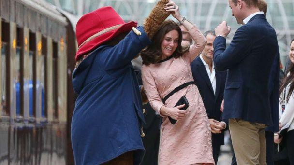 PHOTO: Catherine, Duchess of Cambridge dances with Paddington bear on platform 1 at Paddington Station as she meets the cast and crew from the forthcoming film Paddington 2 at Paddington Station on Oct. 16, 2017. (Jonathan Brady - WPA Pool/Getty Images)