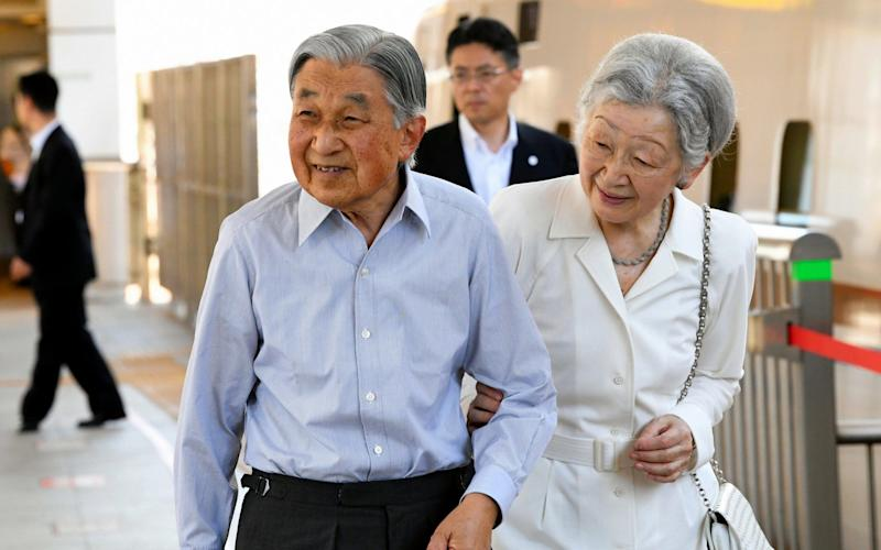 Emperor Akihito and Empress Michiko at Tokyo Station in August. The Emperor is due to abdicate in April next year - The Asahi Shimbun