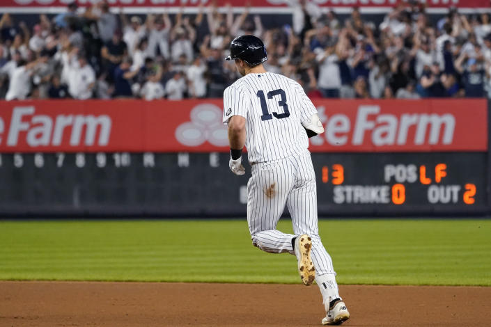 New York Yankees' Joey Gallo runs the bases after hitting a three-run home run during the seventh inning of the team's baseball game against the Seattle Mariners, Thursday, Aug. 5, 2021, in New York. (AP Photo/Mary Altaffer)