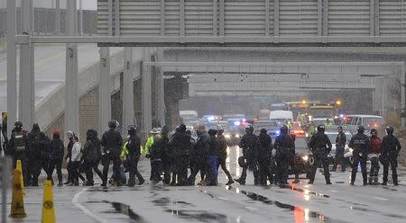 A group of Black Lives Matter protesters shut down the main road to the Minneapolis St. Paul Airport after a protest at the Mall of America in Bloomington, Minnesota December 23, 2015. REUTERS/Craig Lassig