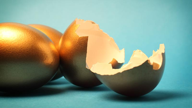 Gold eggs and cracked open shells.