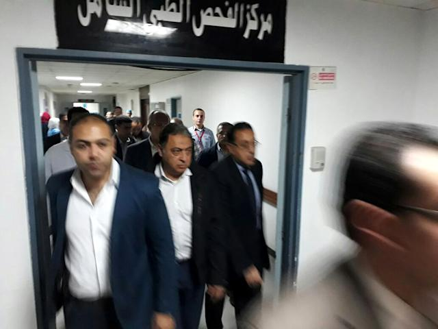 <p>Egyptian Minister of Health and Population Ahmed Emad Eldin Rady (C) arrives to visit victims injured in Sinai mosque attack after they were transferred to hospital in Cairo, Egypt, Nov. 24, 2017. (Photo: Mohamed Hossam/EPA-EFE/REX/Shutterstock) </p>