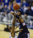 Connecticut forward Tyler Polley (12) block a shot from Creighton guard Denzel Mahoney (34) in the first half during an NCAA college basketball game Saturday, Jan. 23, 2021, in Omaha, Neb. (AP Photo/John Peterson)