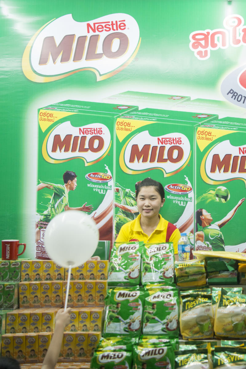 a nestle and milo shop at the market at the Pha That Luang Festival in the city of vientiane in Laos in the southeastasia.