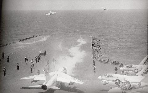 US navy jets take off from the deck of USS Constellation south-east of Saigon, on bombing missions during the Vietnam war, 1972 - Credit: Bettmann