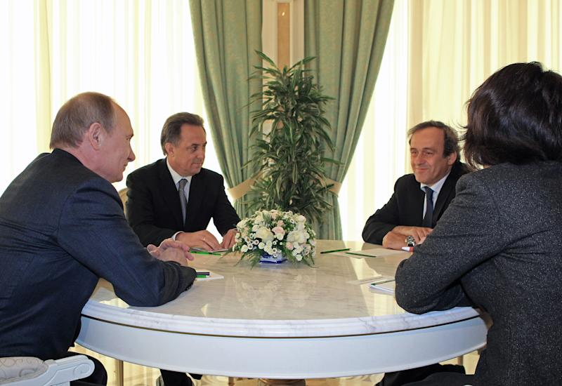Russian President Vladimir Putin, left, meets with UEFA President Michel Platini, second right, in the Bocharov Ruchei residence in the Black Sea resort of Sochi, Russia, Wednesday, April 17, 2013. Second left is Russian Sports Minister Vitaly Mutko. (AP Photo/RIA-Novosti, Mikhail Klimentyev, Presidential Press Service)