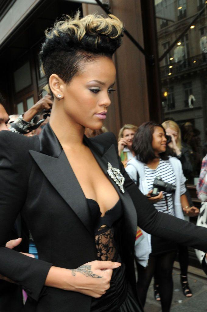 <p>Rihanna has added to her hand tattoos over the years. In 2009, before Bang Bang got to work, she had this print around her thumb. Then in 2013, while touring in New Zealand, she got a traditional Maori tribal print tattooed using a mallet, ink pigment and a chisel. </p>
