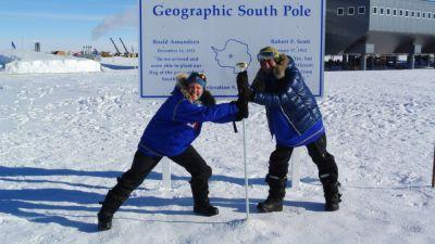 Members of the Test Your Limits team fight over the South Pole marker.