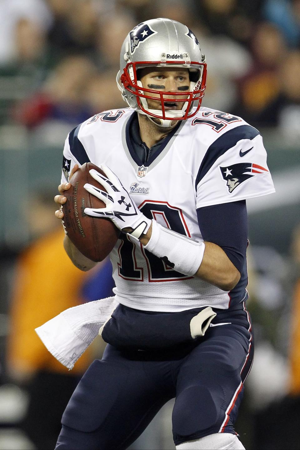New England Patriots quarterback Tom Brady (12) looks to pass during the first half of an NFL football game against the New York Jets, Thursday, Nov. 22, 2012, in East Rutherford, N.J. (AP Photo/Julio Cortez)