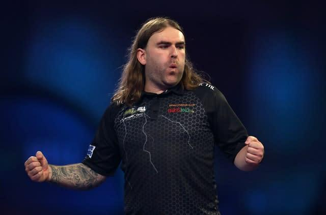 Ryan Searle faced a match dart against him before sealing victory (Steven Paston/PA)