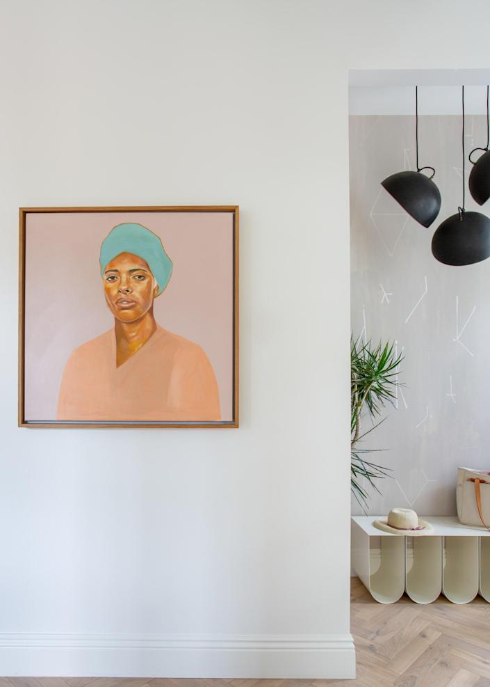 """<div class=""""caption""""> Regan was sourcing art for the project when the Black Lives Matter movement began and decided to use this opportunity to support artists of color, such as <a href=""""https://www.tawnychatmon.com/"""" rel=""""nofollow noopener"""" target=""""_blank"""" data-ylk=""""slk:Tawny Chatmon"""" class=""""link rapid-noclick-resp"""">Tawny Chatmon</a>, <a href=""""https://www.instagram.com/laurenpearce_designs/"""" rel=""""nofollow noopener"""" target=""""_blank"""" data-ylk=""""slk:Lauren Pearce"""" class=""""link rapid-noclick-resp"""">Lauren Pearce</a>, <a href=""""https://www.christadavid.com/"""" rel=""""nofollow noopener"""" target=""""_blank"""" data-ylk=""""slk:Christa David"""" class=""""link rapid-noclick-resp"""">Christa David</a>, and <a href=""""https://www.instagram.com/musebymarie/"""" rel=""""nofollow noopener"""" target=""""_blank"""" data-ylk=""""slk:Marie Alexander"""" class=""""link rapid-noclick-resp"""">Marie Alexander</a>. The piece shown above is <em>Shura</em> by Lauren Pearce. </div>"""