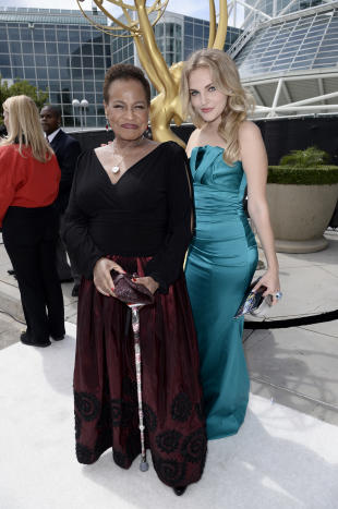 Michelle Hurst and Madeline Brewer arrives at the 66th Primetime Emmy Awards at the Nokia Theatre L.A. Live on Monday, Aug. 25, 2014, in Los Angeles. (Photo by Dan Steinberg/Invision for the Television Academy/AP Images)