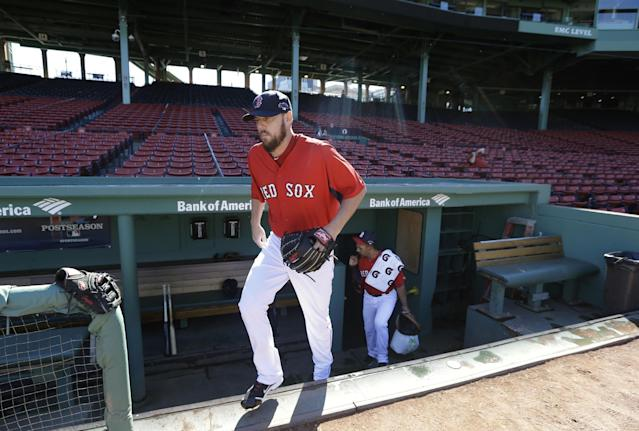 Boston Red Sox pitcher John Lackey steps out of the dugout and onto the field during a baseball team workout on Tuesday, Oct. 1, 2013, at Fenway Park in Boston. The Red Sox host Game 1 of the AL divisional series on Friday, Oct. 4, against the winner of Wednesday's wild-card playoff game between the Cleveland Indians and Tampa Ray Rays. (AP Photo/Steven Senne)