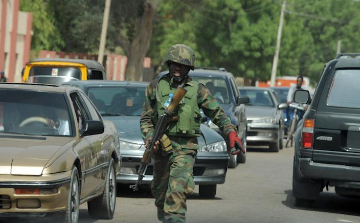 An officer of the Joint Military Task Force walks in the northeastern Nigerian town of Maiduguri, Borno State, on April 30, 2013 (AFP Photo/Pius Utomi Ekpei)