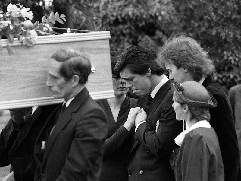 Jeremy Bamber (centre) appears grief-stricken at the funeral in 1985 of his adoptive parents, Nevill and June, and sister Sheila. He was later convicted of the murder of all three, as well as that of Sheila's six-year-old twin sons: PA