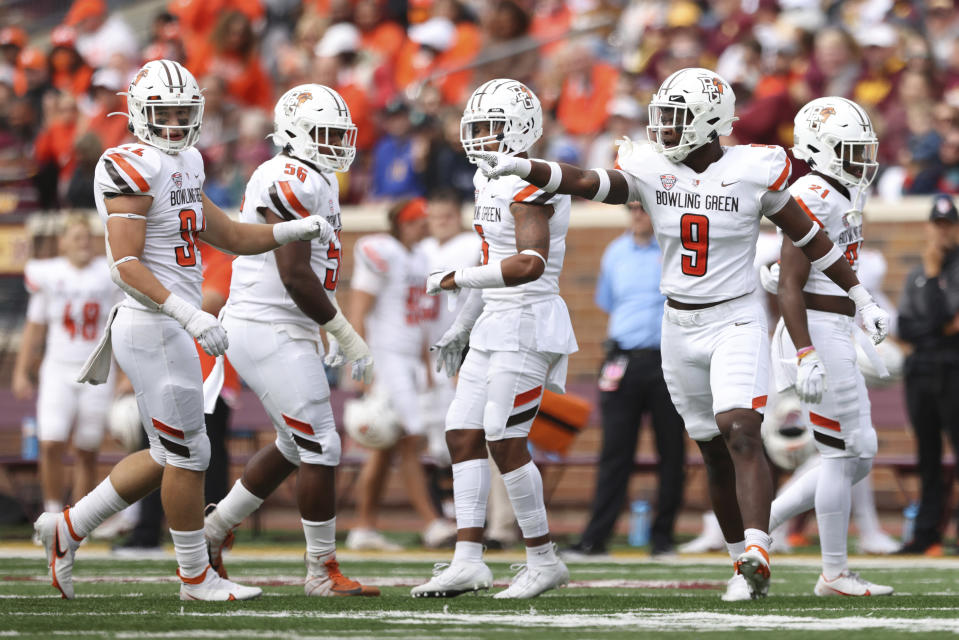 Bowling Green defensive lineman Blaine Spires (9) calls out to his team during the second half of an NCAA college football game against Minnesota, Saturday, Sept. 25, 2021, in Minneapolis. Bowling Green won 14-10. (AP Photo/Stacy Bengs)