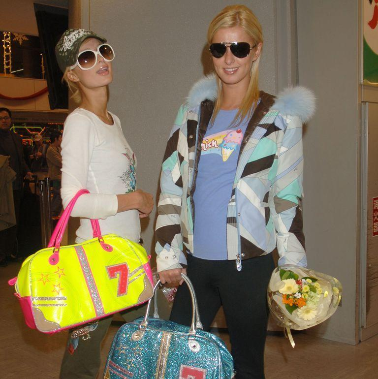 <p>Paris Hilton and Nicky Hilton arrive in Tokyo to attend a Christmas event in December 2005.</p>