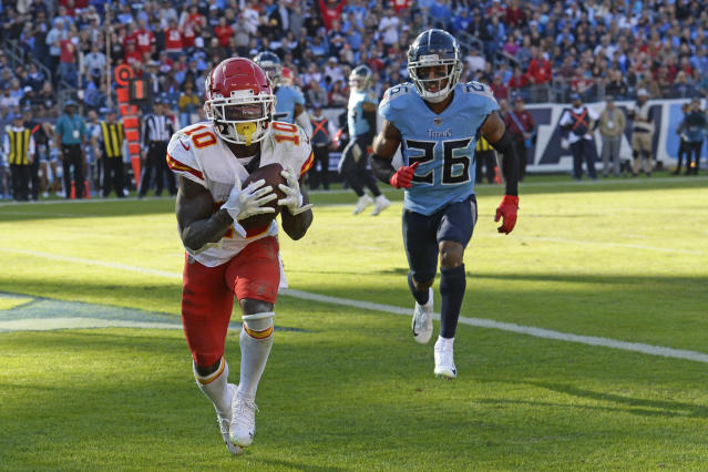 Kansas City Chiefs wide receiver Tyreek Hill (10) catches a touchdown pass ahead of Tennessee Titans cornerback Logan Ryan (26) in the second half of an NFL football game Sunday, Nov. 10, 2019, in Nashville, Tenn. (AP Photo/Mark Zaleski)