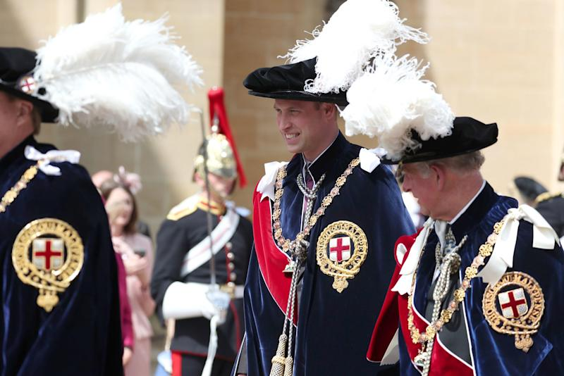 The Duke of Cambridge (centre) walks with his father the Prince of Wales (PA)