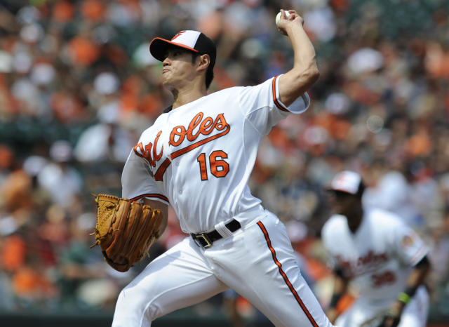 Baltimore Orioles pitcher Wei-Yin Chen delivers against the Minnesota Twins in the first inning of a baseball game, Sunday, Aug. 31, 2014, in Baltimore. (AP Photo/Gail Burton)