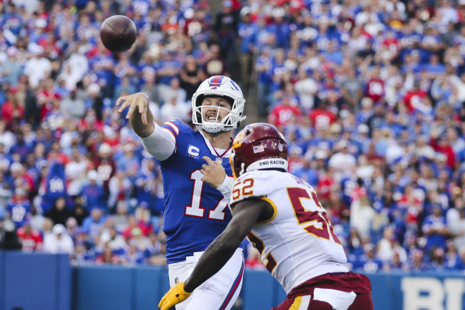 Buffalo Bills quarterback Josh Allen (17) throws a pass over Washington Football Team's Jamin Davis (52) to Dawson Knox for a touchdown during the first half of an NFL football game Sunday, Sept. 26, 2021, in Orchard Park, N.Y. (AP Photo/Jeffrey T. Barnes)