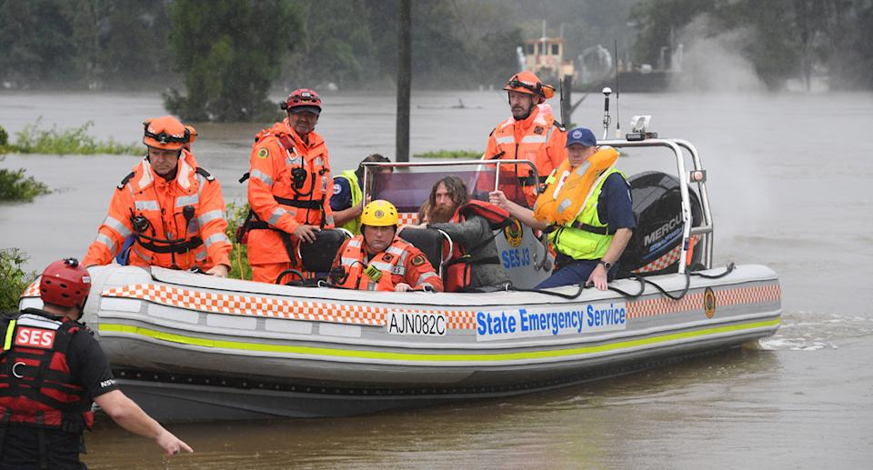 A family of four, including two young children, had their rescue boat capsize during their evacuation from a flooded property at Upper Colo. Source: AAP