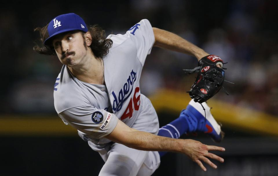 Los Angeles Dodgers starting pitcher Tony Gonsolin delivers against the Arizona Diamondbacks during the first inning of a baseball game Wednesday, June 26, 2019, in Phoenix. (AP Photo/Ross D. Franklin)