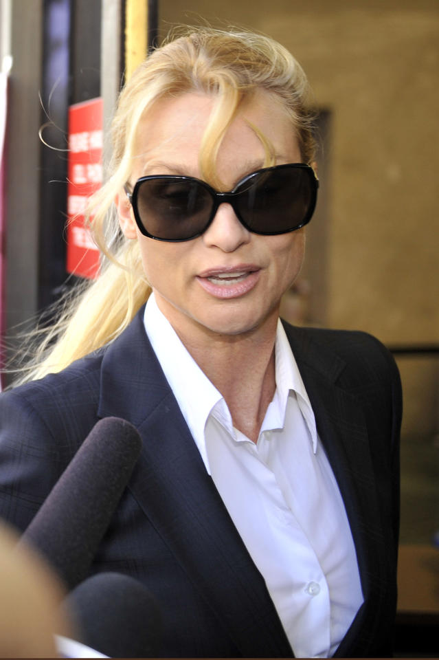 "LOS ANGELES, CA - MARCH 01: Nicollette Sheridan arrives in court where she will be taking the stand for opening arguments in her ""Desperate Housewives"" lawsuit at County Courthouse on March 1, 2012 in Los Angeles, California. Sheridan is claiming that killing her character, Edie Britt, is wrongful termination of employment.  (Photo by Toby Canham/Getty Images)"