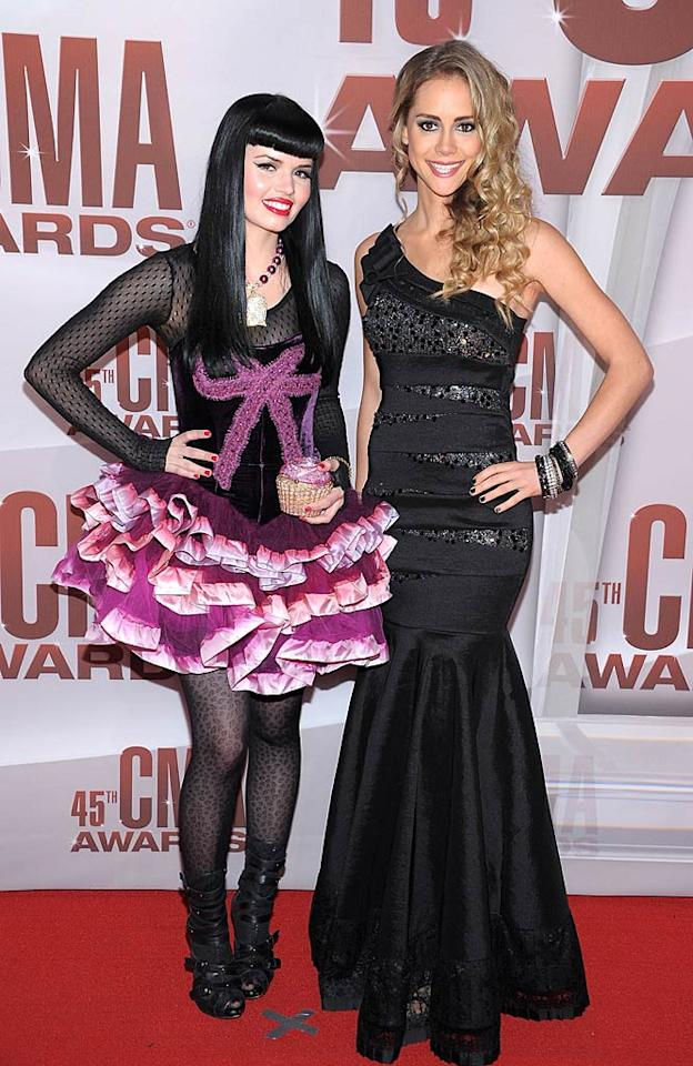 The JaneDear Girls -- Susie Brown and Danelle Leverett -- sported very different looks at the event. While Brown opted for an over-the-top corset and tutu combo (and cupcake clutch!), her bandmate Leverett decided to don a Mariah Carey-like one-shoulder gown. Who deserves to win this fashion faceoff? (11/9/2011)
