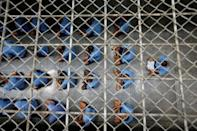 Inmates sit on the floor during an inspection visit in the long-term sentence zone inside Klong Prem high-security prison in Bangkok, Thailand July 12, 2016. REUTERS/Jorge Silva