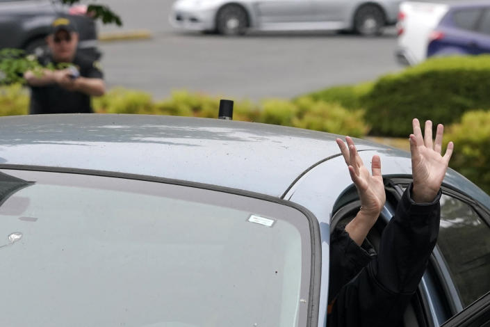 An instructor playing the role of a suspect in a vehicle sticks her hands out of a car door during a training class at the Washington state Criminal Justice Training Commission, Wednesday, July 14, 2021, in Burien, Wash. Washington state is embarking on a massive experiment in police reform and accountability following the racial justice protests that erupted after George Floyd's murder last year, with nearly a dozen new laws that took effect Sunday, July 25, but law enforcement officials remain uncertain about what they require in how officers might respond — or not respond — to certain situations, including active crime scenes and mental health crises. (AP Photo/Ted S. Warren)